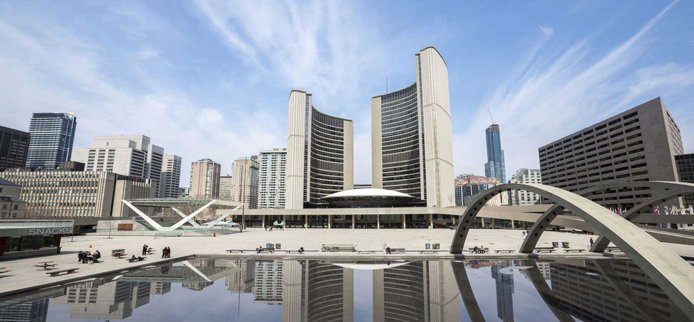 Toronto City Hall with water view from Nathan Phillips Square